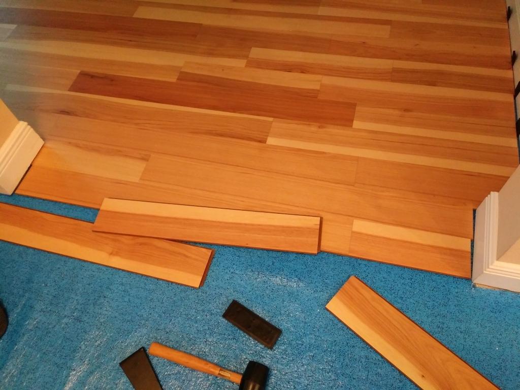 Installing engineered wood flooring. FitlifeandTravel.com Do It Yourself Adventures